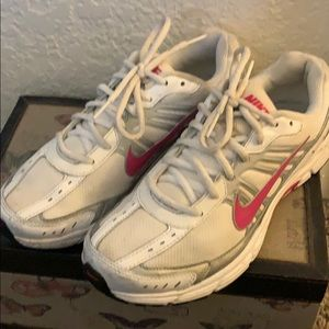 Previously worn Nike running shoes